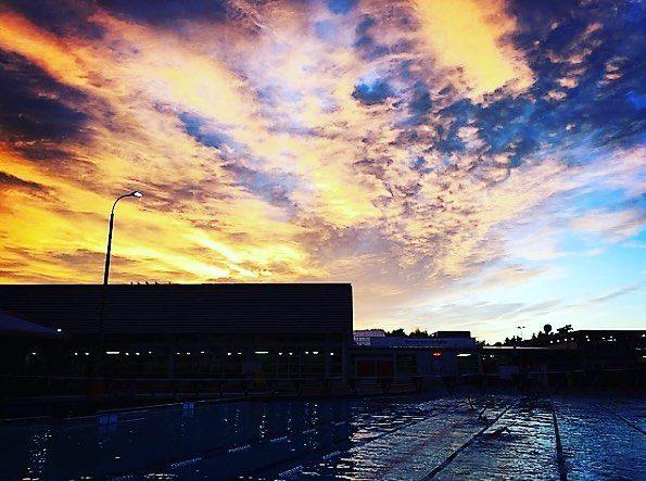 Swimming at sunrise