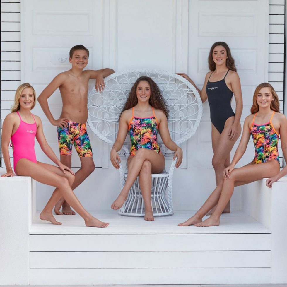 AMANZI MS19 Collection shoot featuring a group shot with focus on the neopn palm tree Electric Oasis design