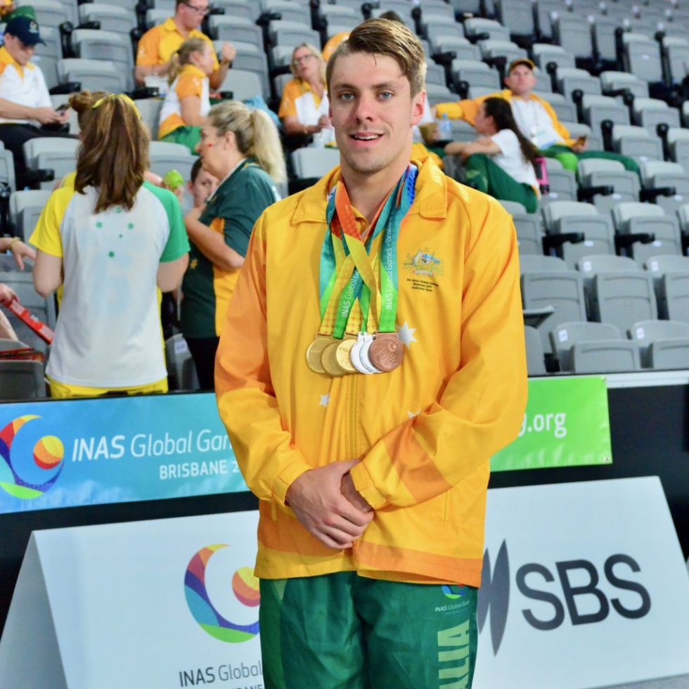 Jack Ireland poses with medals earned at the 2019 Brisbane Global Games