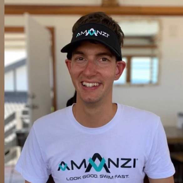 Paralympic Swimmer matt Haanappel smiles at camera in his AMANZI Squad shirt and hat