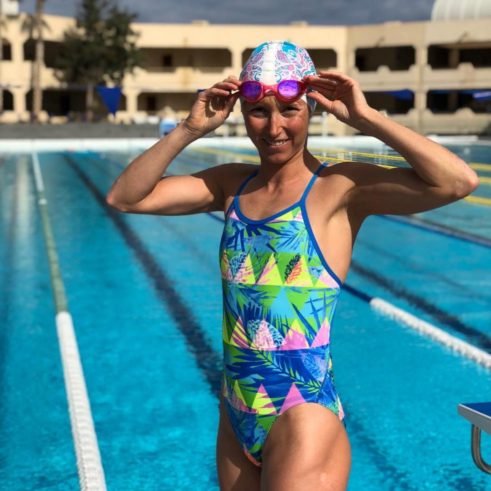 Professional Triathlete Vendula Frintova put on her ca and goggles for pool training.