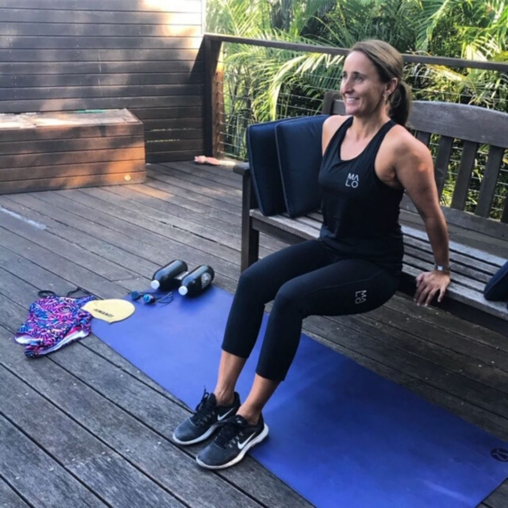 Personal Trainer completes home workout using a bench