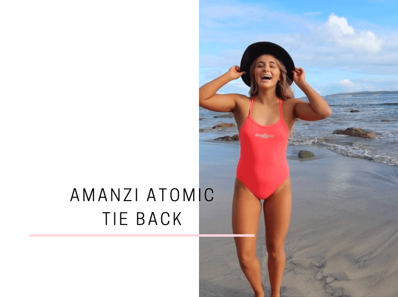 Milly is all smiles in her Atomic Tie Back! This sweet, peachy coloured Tie Back is full of explosive style.
